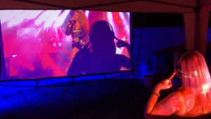 Girl creating a shadow on a Super Silent Discos projector screen