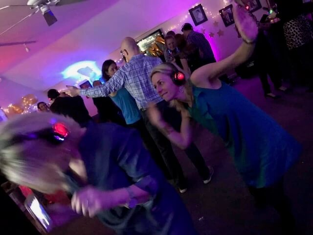 Lady dancing at a Super Silent Disco