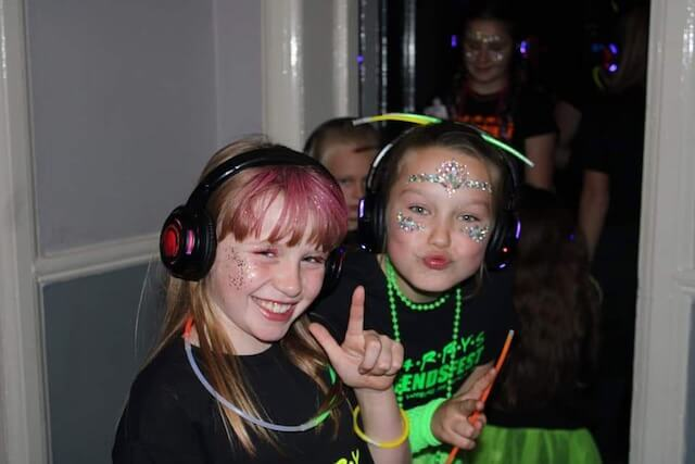 Two Children Posing at a Super Silent Disco