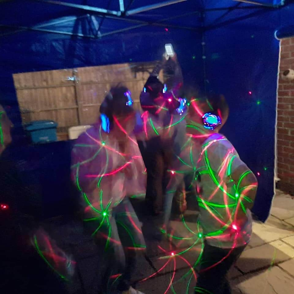 Silent Disco Outdoors with laser beams over the dancers
